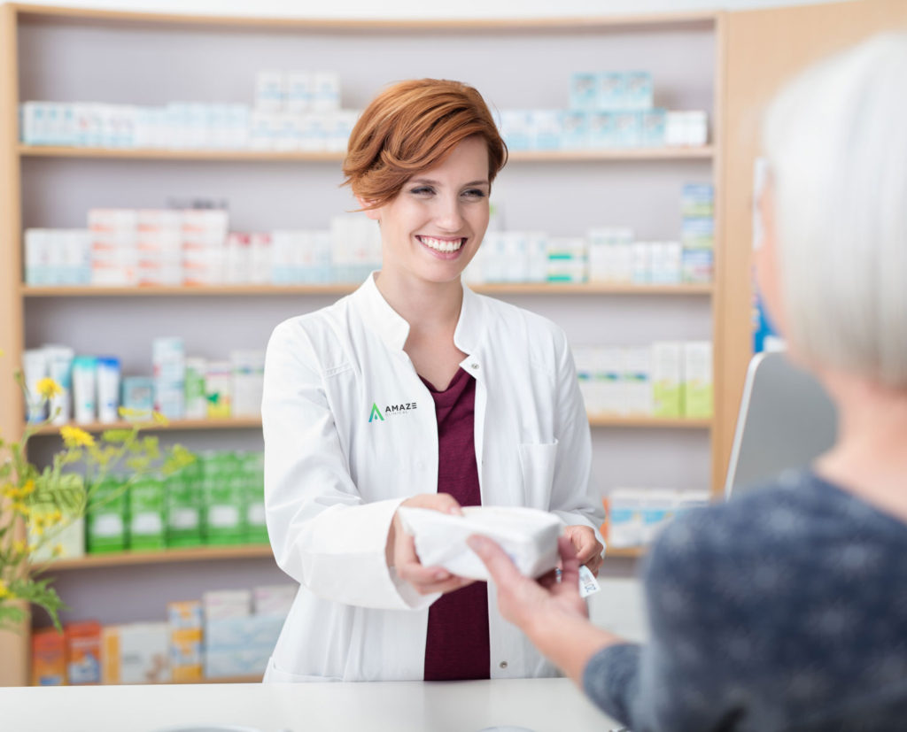 Woman at pharmacy counter